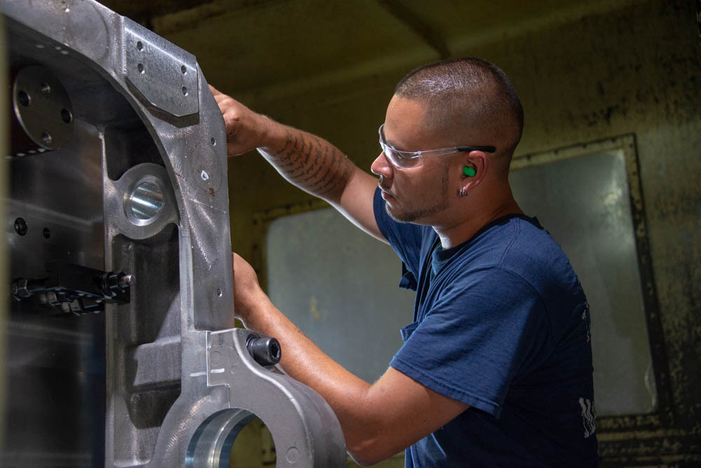 flinchbaugh employee working with a machined part